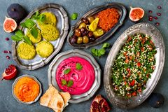 Middle Eastern traditional dinner. Authentic arab cuisine. Meze party food. Top view, flat lay. Overhead Royalty Free Stock Photography