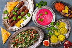 Middle Eastern traditional dinner. Authentic arab cuisine. Meze party food. Top view, flat lay, overhead. royalty free stock image
