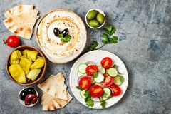 Middle Eastern traditional dinner. Authentic arab cuisine. Meze party food. Top view, flat lay, overhead. Middle Eastern traditional dinner. Authentic arab royalty free stock image