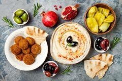 Middle Eastern traditional dinner. Authentic arab cuisine. Meze party food. Top view, flat lay, overhead. Middle Eastern traditional dinner. Authentic arab stock image