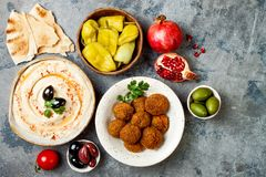 Middle Eastern traditional dinner. Authentic arab cuisine. Meze party food. Top view, flat lay, overhead. Middle Eastern traditional dinner. Authentic arab royalty free stock photo