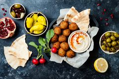 Middle Eastern traditional dinner. Authentic arab cuisine. Meze party food. Top view, flat lay, overhead. Middle Eastern traditional dinner. Authentic arab stock photography