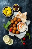 Middle Eastern traditional dinner. Authentic arab cuisine. Meze party food. Top view. Flat lay, overhead royalty free stock images