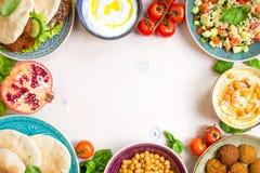 Middle eastern traditional dishes background. Middle eastern traditional dishes on a white background. Doner kebap, vegetarian pita, bowl with hummus, falafel Royalty Free Stock Photos