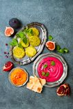 Middle Eastern traditional food. Authentic arab cuisine. Vegan green baked falafel, roasted beet and pumpkin hummus. stock photo