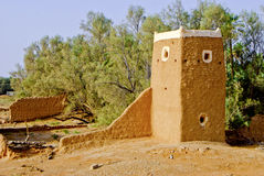 Middle-Eastern Watchtower and Wall Ruins Made of Mud. Ruined Walls and structure made of Red Clay or Mud in a countryside in the Middle East stock photography