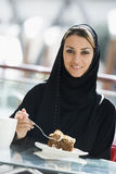 A Middle Eastern woman enjoying a meal Royalty Free Stock Photo
