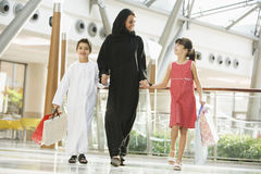 A Middle Eastern woman family in a mall. A Middle Eastern woman with two children in a shopping mall Royalty Free Stock Image