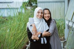 Middle eastern woman friend together stock images