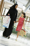 A Middle Eastern woman with a girl shopping. A Middle Eastern woman with a girl in a shopping mall Stock Photos
