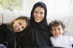 A Middle Eastern woman with her children