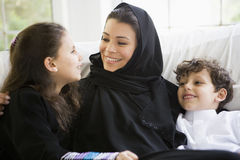 A Middle Eastern woman with her children royalty free stock photos