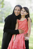 A Middle Eastern woman and her daughter Stock Photography