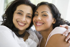 A Middle Eastern woman with her daughter-in-law stock photo