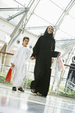 A Middle Eastern woman and her son in a mall Stock Photography