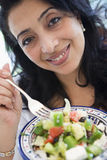 Middle Eastern woman holding a salad Royalty Free Stock Photo