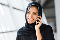 Middle eastern woman mobile phone. Pretty middle eastern woman talking on mobile phone Royalty Free Stock Photo