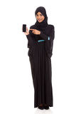 Middle eastern woman phone. Pretty middle eastern woman pointing at smart phone isolated on white Stock Photos