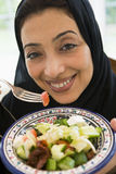 A Middle Eastern woman with a plate of salad Stock Photos