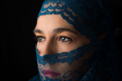 Middle Eastern woman portrait looking sad with blue hijab artist Stock Image