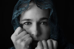 Middle Eastern woman portrait looking sad with blue hijab artist Stock Photos