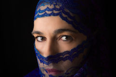 Middle Eastern woman portrait looking sad with blue hijab artist Royalty Free Stock Images