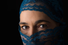 Middle Eastern woman portrait looking sad with blue hijab artist Stock Photo