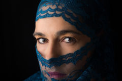 Middle Eastern woman portrait looking sad with blue hijab artist Stock Photography