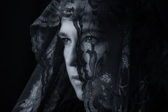 Middle Eastern woman portrait looking sad with blue hijab artist Stock Images