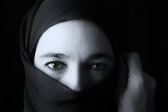 Middle Eastern woman portrait looking sad with hijab artistic co Royalty Free Stock Photography