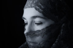Middle Eastern woman portrait looking sad with hijab artistic co Stock Photography