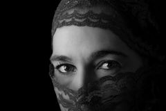 Middle Eastern woman portrait looking sad with hijab artistic co Stock Photos