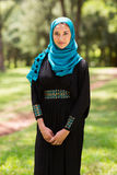 Middle eastern woman. Pretty middle eastern woman standing outdoors Royalty Free Stock Images