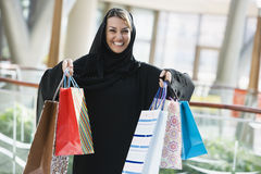 A Middle Eastern woman in a shopping mall Royalty Free Stock Images
