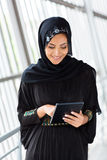Middle eastern woman tablet. Happy middle eastern woman using tablet computer Stock Images