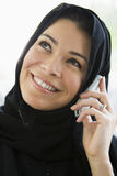 A middle eastern woman talking on a cellphone.  Royalty Free Stock Photos