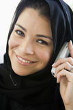A middle eastern woman talking on a cellphone.  Stock Photos