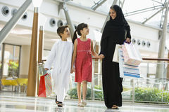 A Middle Eastern woman with two children shoping Royalty Free Stock Image
