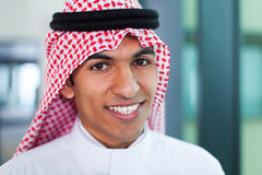 Middle eastern worker. Young middle eastern corporate worker in modern office Stock Photos