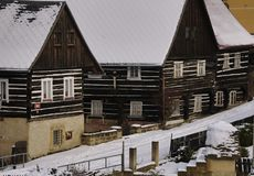 Rustically European log building in winter. Stock Images