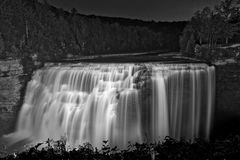 The Middle Falls At Letchworth Under The Lights. The Middle Falls At Letchworth State Park In New York At Night Under The Lights In Black And White Stock Images