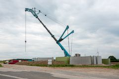 a wind turbine is erected with the help of a large crane stock image