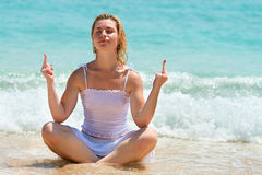 Middle finger gesture by woman on a beach Stock Image