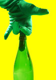 Middle Finger in Green Glass Bottle. Middle finger with glove on, stuck in a green glass bottle Stock Photography