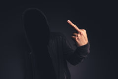 Middle finger offensive hand gesture Stock Images