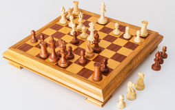 Middle game with lots of chess pieces on Board Royalty Free Stock Image