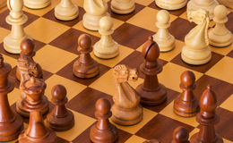 Middle game with lots of chess pieces on Board Royalty Free Stock Images