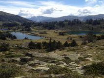 In the middle of high mountains, viewsight of three lakes in the reserve of high pyrenees neouvielle France, stock image