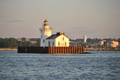 Middle of lake. On boat passing a old light house that sits in the middle of lake erie stock photography