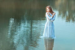 In the middle lake there is a girl. Stock Photos